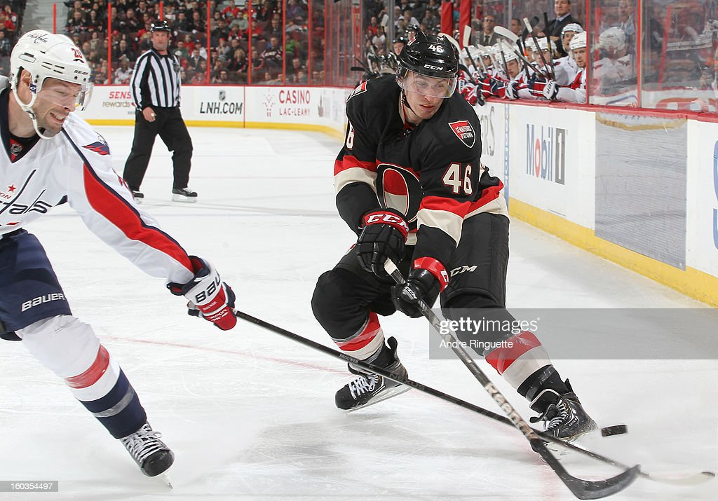 Patrick Wiercioch #46 of the Ottawa Senators reaches with his stick to chip the puck past <a gi-track='captionPersonalityLinkClicked' href=/galleries/search?phrase=Troy+Brouwer&family=editorial&specificpeople=4155305 ng-click='$event.stopPropagation()'>Troy Brouwer</a> #20 of the Washington Capitals on January 29, 2013 at Scotiabank Place in Ottawa, Ontario, Canada.