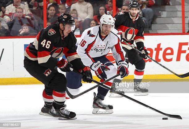 Patrick Wiercioch of the Ottawa Senators stickhandles the puck against Eric Fehr of the Washington Capitals during an NHL game at Canadian Tire...