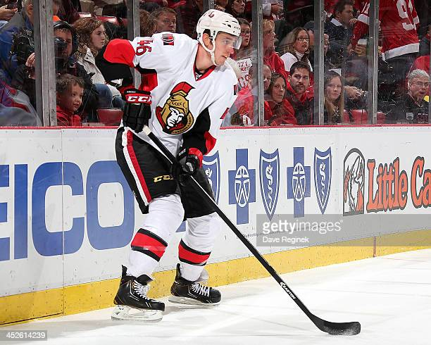 Patrick Wiercioch of the Ottawa Senators stops behind the net with the puck during an NHL game against the Detroit Red Wings at Joe Louis Arena on...