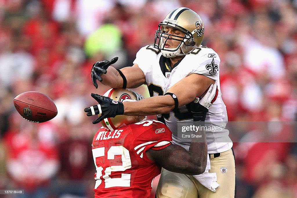 <a gi-track='captionPersonalityLinkClicked' href=/galleries/search?phrase=Patrick+Willis&family=editorial&specificpeople=2218577 ng-click='$event.stopPropagation()'>Patrick Willis</a> #52 of the San Francisco 49ers forces an incomplete pass against <a gi-track='captionPersonalityLinkClicked' href=/galleries/search?phrase=Jimmy+Graham&family=editorial&specificpeople=834247 ng-click='$event.stopPropagation()'>Jimmy Graham</a> #80 of the New Orleans Saints during the fourth quarter of the NFC Divisional playoff game at Candlestick Park on January 14, 2012 in San Francisco, California.
