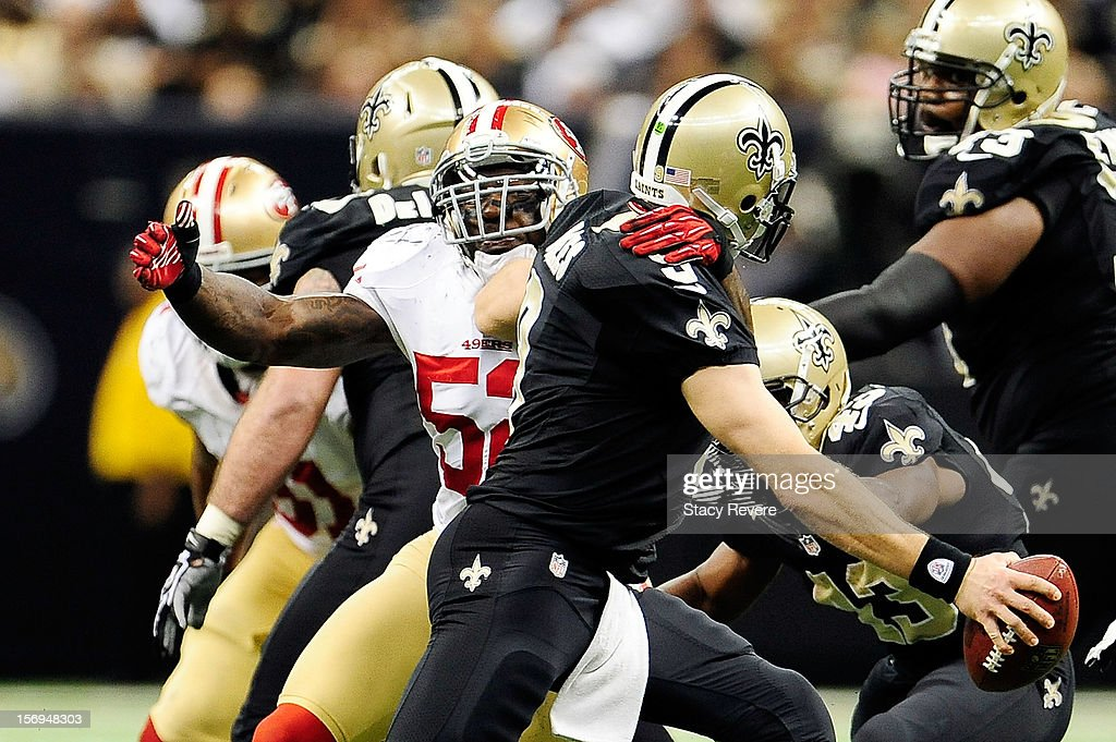 Patrick Willis #52 of the San Francisco 49ers sacks Drew Brees #9 of the New Orleans Saints during a game at the Mercedes-Benz Superdome on November 25, 2012 in New Orleans, Louisiana.