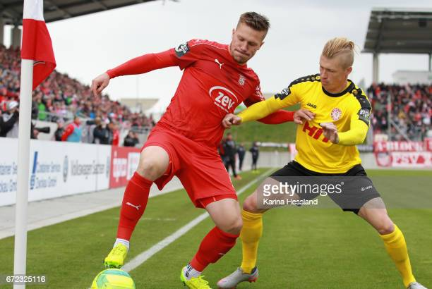Patrick Wolf of Zwickau challenges Michael Kessel of Koeln during the Third League match between FSV Zwickau and Fortuna Koeln on April 23 2017 at...