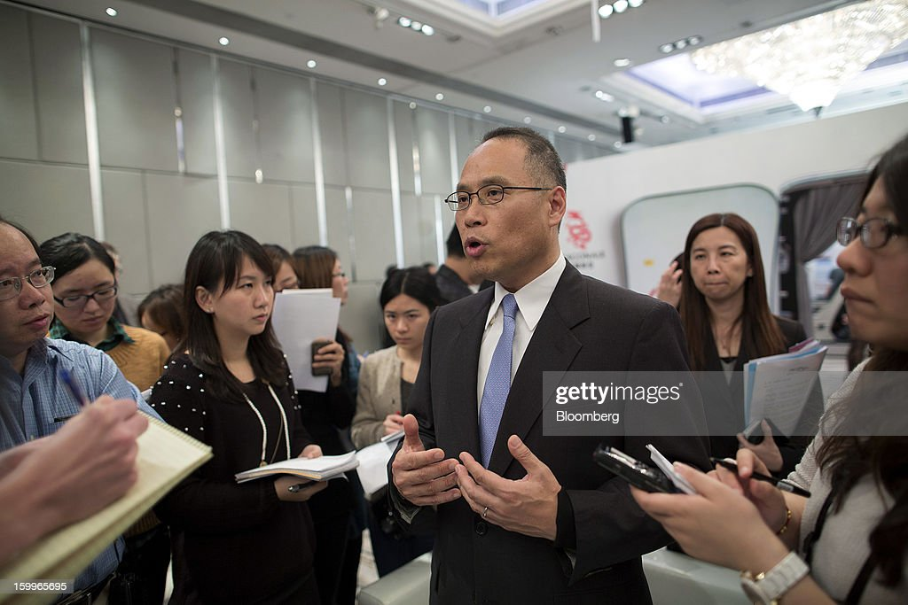 Patrick Yeung, chief executive officer of Hong Kong Dragon Airlines Ltd. (Dragonair), center, speaks during a media briefing in Hong Kong, China, on Thursday, Jan. 24, 2013. Dragonair is to upgrade cabins and add new destinations this year. Photographer: Jerome Favre/Bloomberg via Getty Images