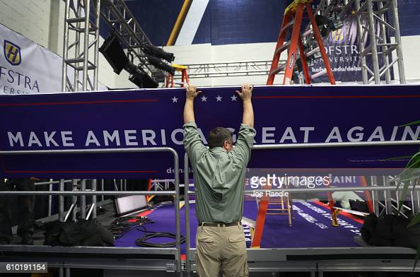 Patrick Young helps setup in the media center before the first US presidential debate at Hofstra University on September 24 2016 in Hempstead New...