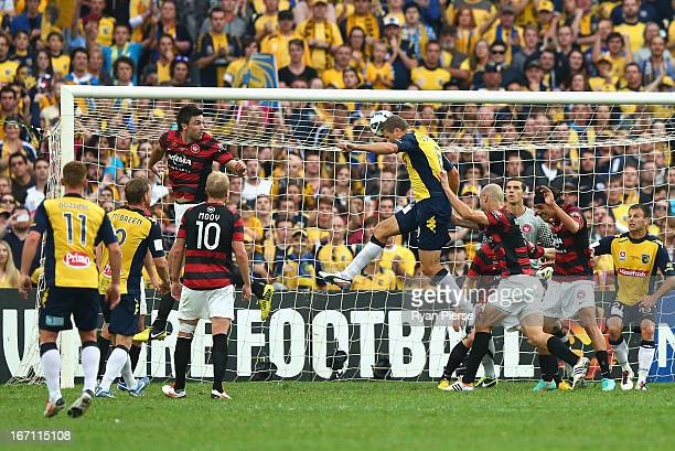 Patrick Zwaanswijk of the Mariners scores his team's first goal during the ALeague 2013 Grand Final match between the Western Sydney Wanderers and...