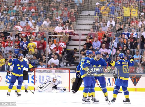 Patrik Berglund celebrates with Carl Soderberg and Erik Karlsson of Team Sweden after scoring a third period goal to against Team North America...