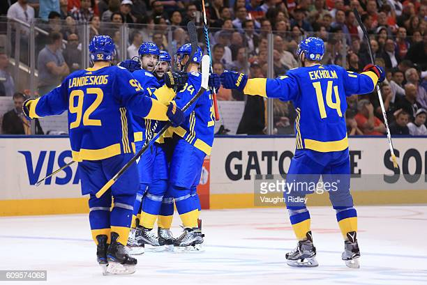 Patrik Berglund celebrates with Gabriel Landeskog Erik Karlsson Carl Soderberg and Mattias Ekholm of Team Sweden after scoring a third period goal on...
