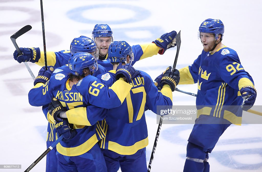 Patrik Berglund #17 of Team Sweden celebrates his game-tying goal in the third period with Erik Karlsson #65 and Carl Soderberg #34 and Gabriel Landeskog #92 and Mattias Ekholm #14 against Team North America during the World Cup of Hockey tournament at the Air Canada Centre on September 21, 2016 in Toronto, Canada.