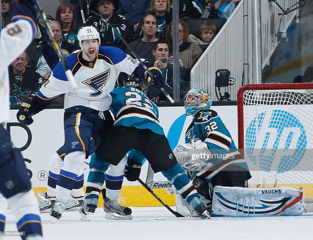 Patrik Berglund #21 of the St. Louis Blues celebrates his game-winning goal in overtime against Dan Boyle #22 and Antti Niemi #31 of the San Jose Sharks during an NHL game on March 9, 2013 at HP Pavilion in San Jose, California.