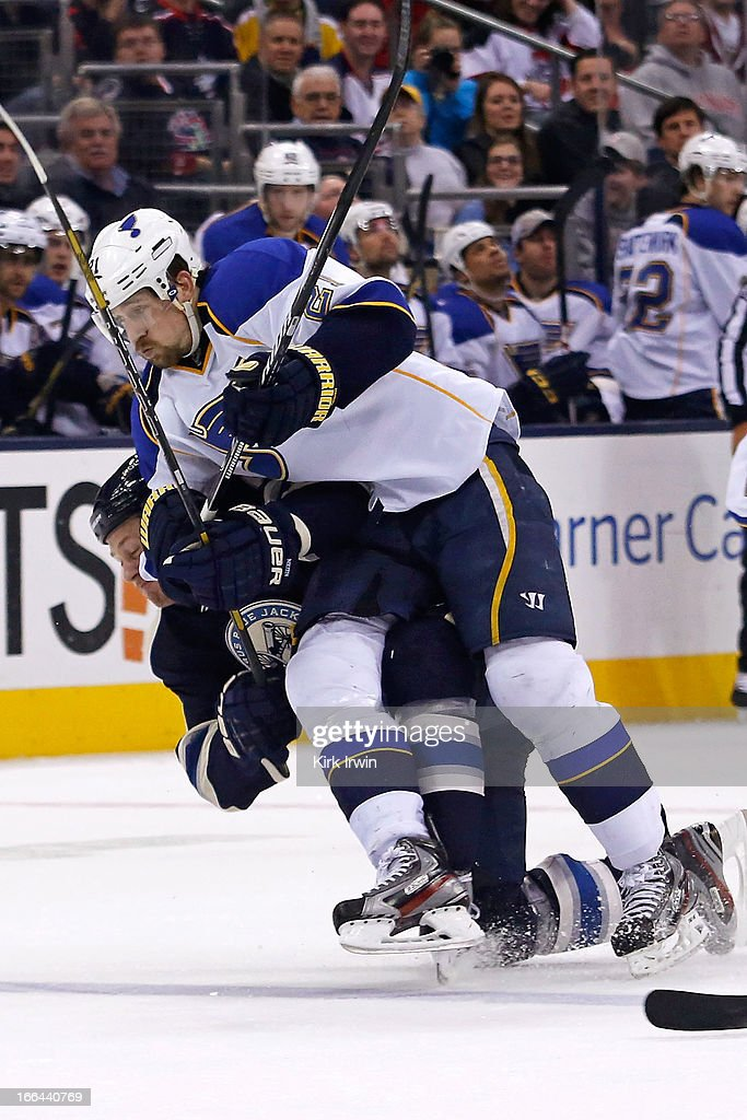 Patrik Berglund #21 of the St. Louis Blues collides with Nikita Nikitin #6 of the Columbus Blue Jackets while chasing after a puck during the third period on April 12, 2013 at Nationwide Arena in Columbus, Ohio. Columbus defeated St. Louis 4-1.