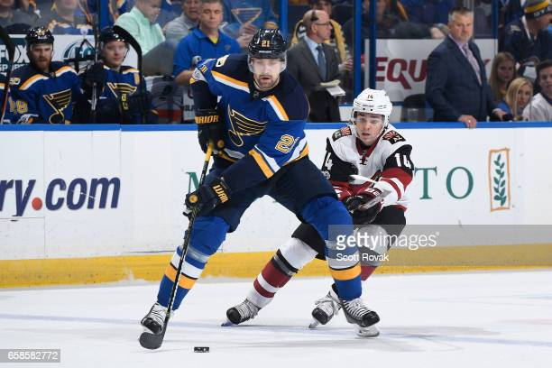 Patrik Berglund of the St Louis Blues controls the puck against the St Louis Blues Clayton Keller of the Arizona Coyotes defends on March 27 2017 at...