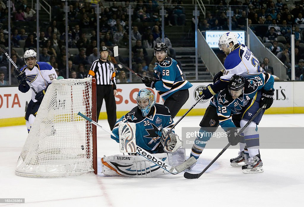 Patrik Berglund #21 of the St. Louis Blues gets the puck past Dan Boyle #22 and goalie Alex Stalock #32 of the San Jose Sharks to score the game-winning goal in overtime at HP Pavilion on March 9, 2013 in San Jose, California.
