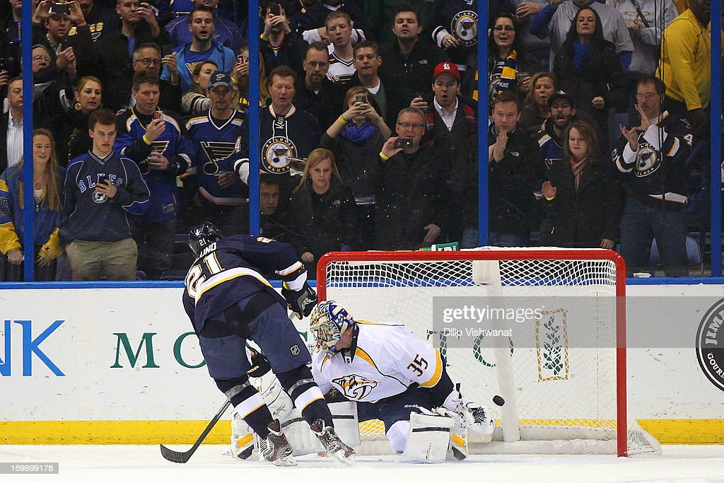 Patrik Berglund #21 of the St. Louis Blues scores on a penalty shot against <a gi-track='captionPersonalityLinkClicked' href=/galleries/search?phrase=Pekka+Rinne&family=editorial&specificpeople=2118342 ng-click='$event.stopPropagation()'>Pekka Rinne</a> #35 of the Nashville Predators at the Scottrade Center on January 24, 2013 in St. Louis, Missouri.