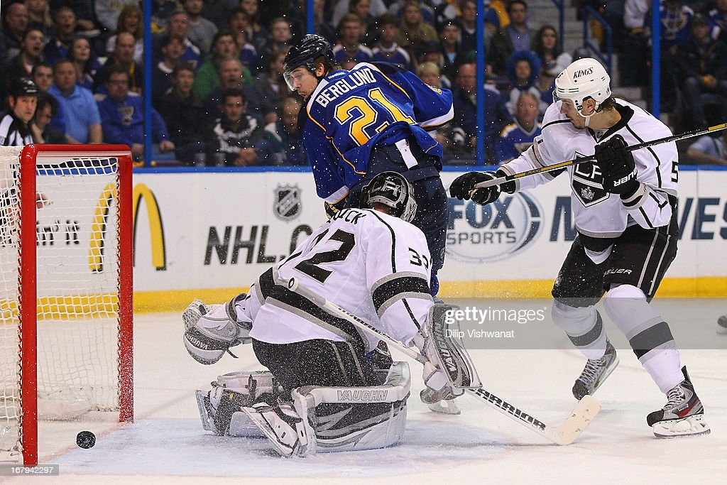 Patrik Berglund #21 of the St. Louis Blues scores the game-tying goal against Jonathan Quick #32 and Keaton Ellerby #5 of the Los Angeles Kings in Game Two of the Western Conference Quarterfinals during the 2013 NHL Stanley Cup Playoffs at the Scottrade Center on May 2, 2013 in St. Louis, Missouri. The Blues beat the Kings 2-1.