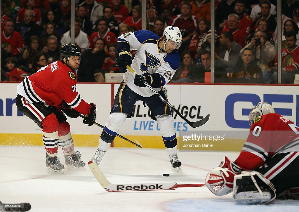 Patrik Berglund #21 of the St. Louis Blues shoots the puck against Corey Crawford #50 of the Chicago Blackhawks as brent Seasbrook #7 defends at the United Center on January 22, 2013 in Chicago, Illinois. The Blackhawks defeated the Blues 3-2.