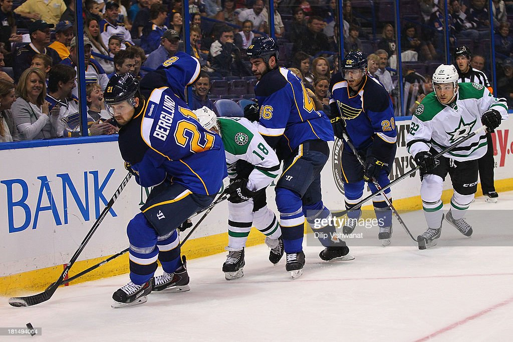 Patrik Berglund #21, Roman Polak #46 and Ian Cole #28 all of the St. Louis Blues chase down a loose puck against Chris Mueller #18 and Colton Sceviour #22 of the Dallas Stars during a preseason at the Scottrade Center on September 21, 2013 in St. Louis, Missouri.