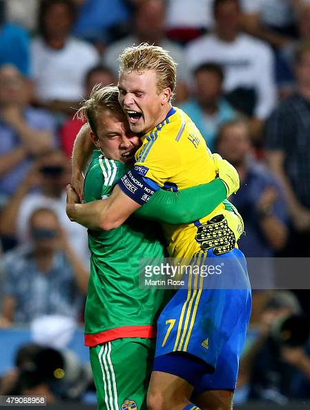 Patrik Carlgren goalkeeper of Sweden celebrate with team mate Oscar Hiljemark after penalty shoot out during the UEFA European Under21 final match...