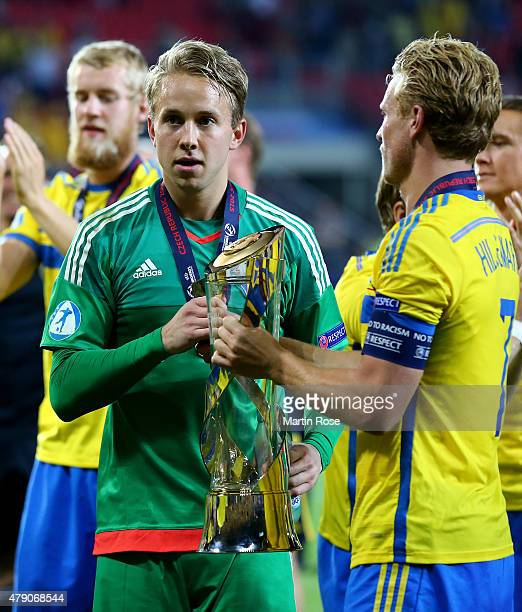 Patrik Carlgren goalkeeper of Sweden lifts the trophy after winning the UEFA European Under21 final match between Sweden and Portugal at Eden Stadium...