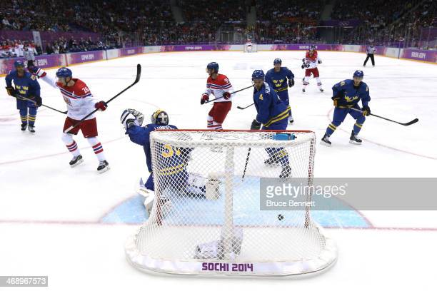 Patrik Elias of Czech Republic celebrates teammate Marek Zidlicky goal in the second period against Henrik Lundqvist of Sweden during the Men's Ice...