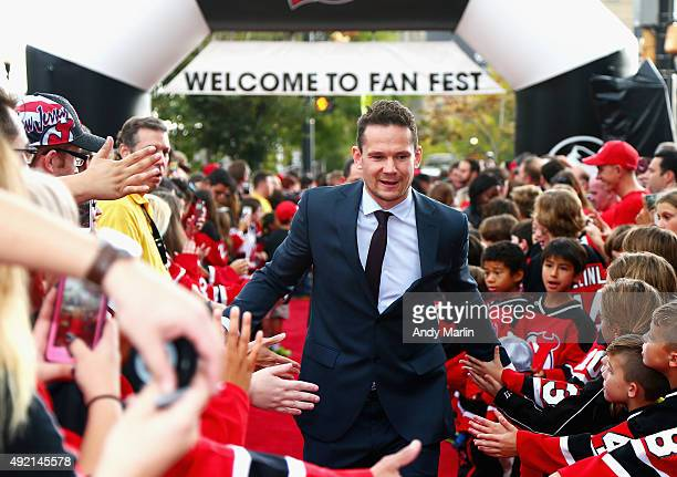 Patrik Elias of New Jersey Devils greets fans during the fan fest prior to opening night against the Winnipeg Jets at the Prudential Center on...