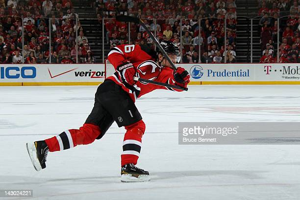 Patrik Elias of the New Jersey Devils breaks his stick on a shot attempt against the Florida Panthers in Game Three of the Eastern Conference...
