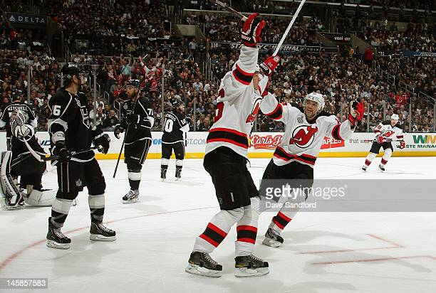 Patrik Elias of the New Jersey Devils celebrates his goal with teammate Petr Sykora of the New Jersey Devils during the third period of Game Four of...
