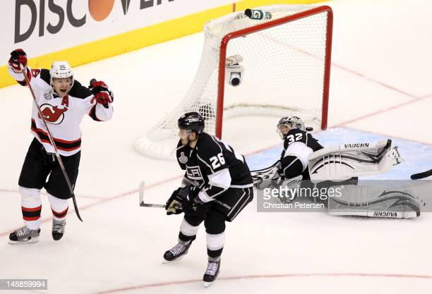 Patrik Elias of the New Jersey Devils celebrates his third period goal over Slava Voynov and goaltender Dustin Brown of the Los Angeles Kings in Game...