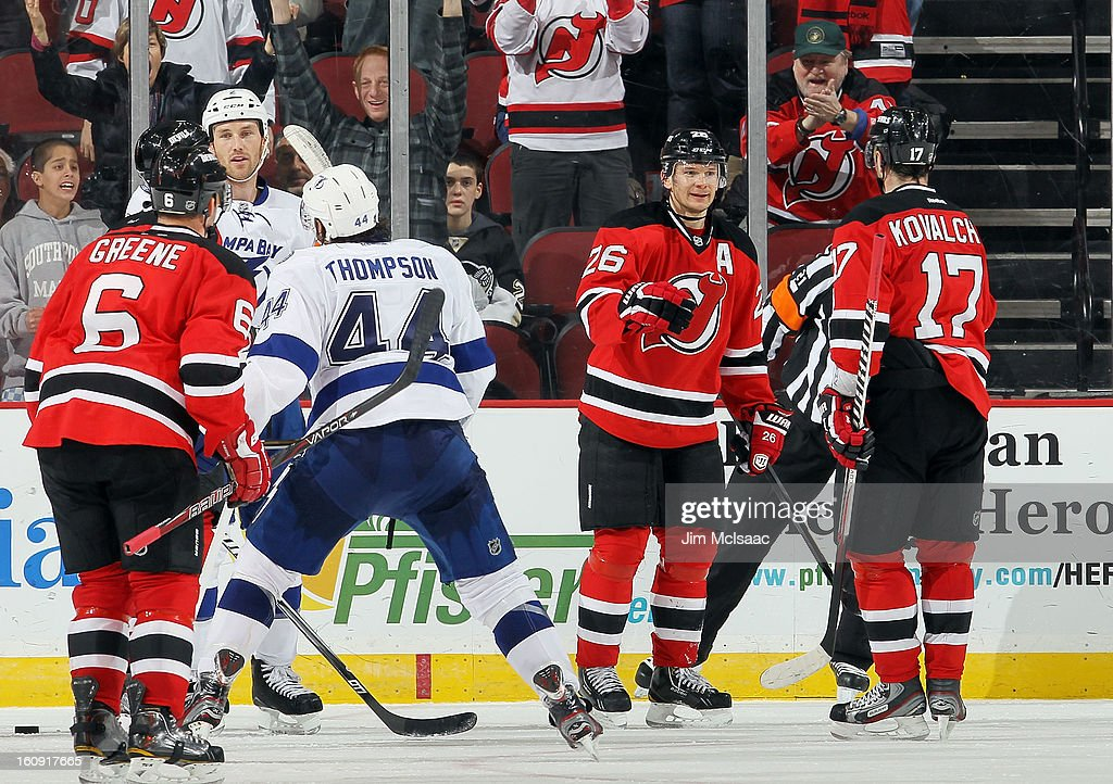 Patrik Elias #26 of the New Jersey Devils celebrates his third period power play goal against the Tampa Bay Lightning with teammate Ilya Kovalchuk #17 at the Prudential Center on February 7, 2013 in Newark, New Jersey.