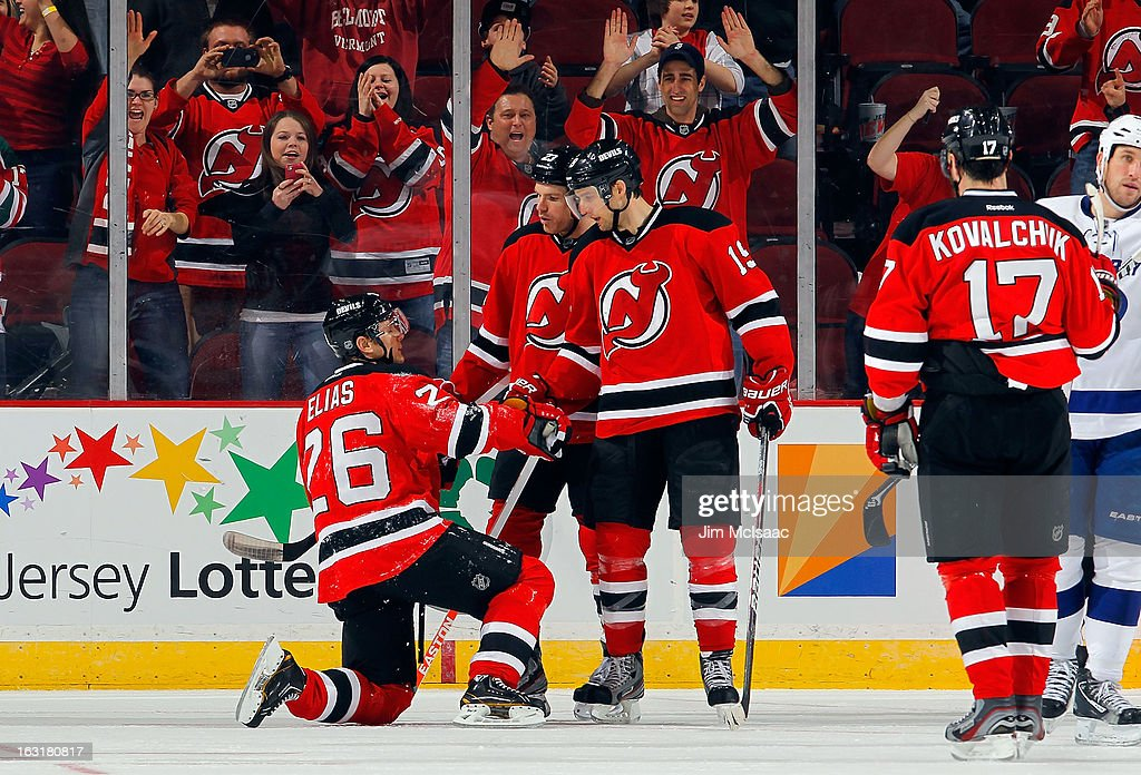 <a gi-track='captionPersonalityLinkClicked' href=/galleries/search?phrase=Patrik+Elias&family=editorial&specificpeople=201827 ng-click='$event.stopPropagation()'>Patrik Elias</a> #26 of the New Jersey Devils celebrates his third period goal against the Tampa Bay Lightning with teammates David Clarkson #23 and <a gi-track='captionPersonalityLinkClicked' href=/galleries/search?phrase=Travis+Zajac&family=editorial&specificpeople=864182 ng-click='$event.stopPropagation()'>Travis Zajac</a> #19 at the Prudential Center on March 5, 2013 in Newark, New Jersey.