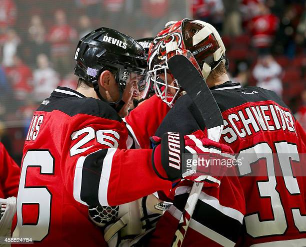 Patrik Elias of the New Jersey Devils celebrates the win with teammate Cory Schneider after the game against the Minnesota Wild on November 11 2014...