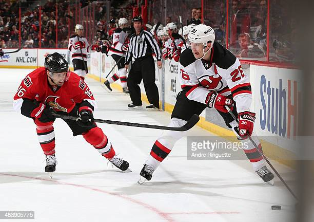 Patrik Elias of the New Jersey Devils controls the puck against Clarke MacArthur of the Ottawa Senators at Canadian Tire Centre on April 10 2014 in...