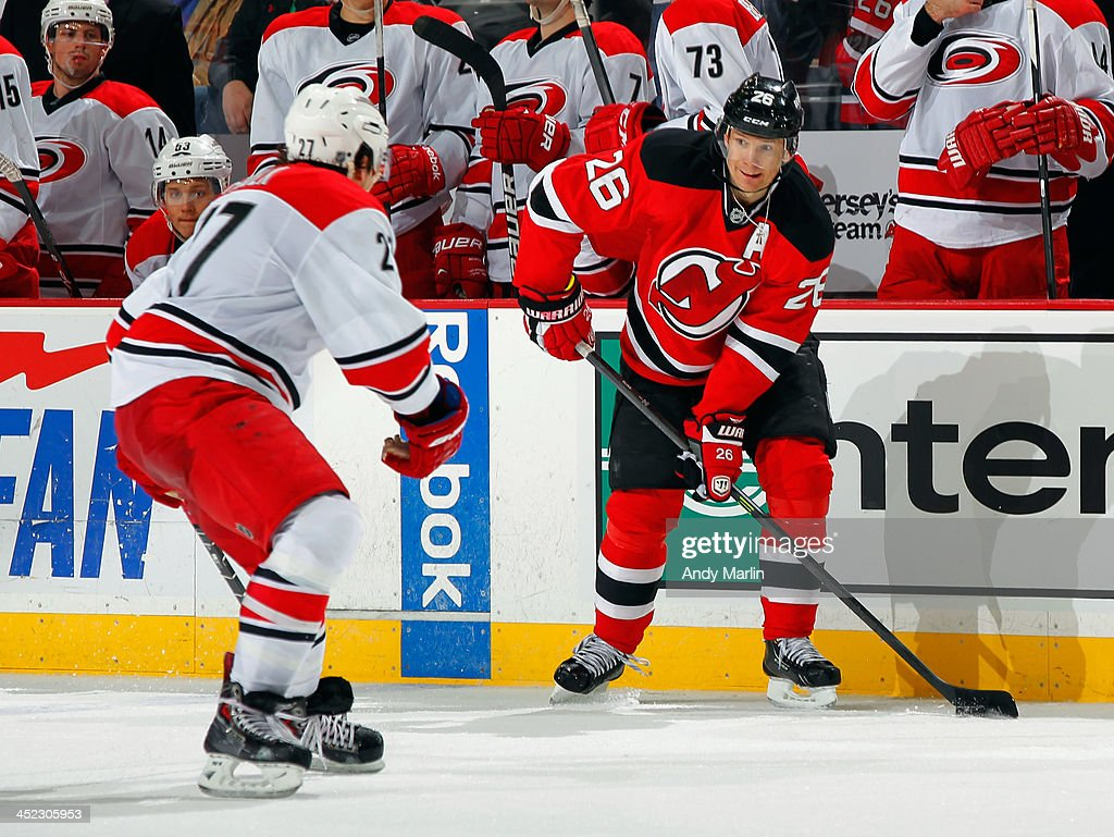 <a gi-track='captionPersonalityLinkClicked' href=/galleries/search?phrase=Patrik+Elias&family=editorial&specificpeople=201827 ng-click='$event.stopPropagation()'>Patrik Elias</a> #26 of the New Jersey Devils controls the puck against the Carolina Hurricanes during the game at the Prudential Center on November 27, 2013 in Newark, New Jersey.