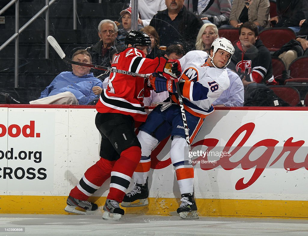 <a gi-track='captionPersonalityLinkClicked' href=/galleries/search?phrase=Patrik+Elias&family=editorial&specificpeople=201827 ng-click='$event.stopPropagation()'>Patrik Elias</a> #26 of the New Jersey Devils hits <a gi-track='captionPersonalityLinkClicked' href=/galleries/search?phrase=Micheal+Haley+-+Ice+Hockey+Player&family=editorial&specificpeople=7557024 ng-click='$event.stopPropagation()'>Micheal Haley</a> #18 of the New York Islanders into the boards at the Prudential Center on April 3, 2012 in Newark, New Jersey. The Devils defeated the Islanders 3-1.
