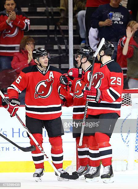 Patrik Elias of the New Jersey Devils is congratulated by teammate Ryane Clowe after Elias scored an empty net goal in the third period against the...