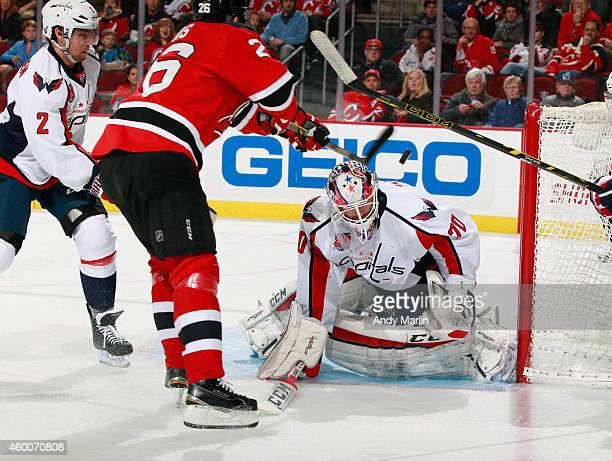 Patrik Elias of the New Jersey Devils knocks the puck in the air past Braden Holtby of the Washington Capitals for a firstperiod goal during the game...