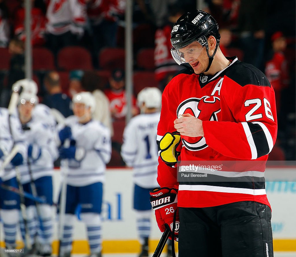Patrik Elias #26 of the New Jersey Devils looks down as he skates off the ice while the Toronto Maple Leafs celebrate in the background after the Leafs defeated the Devils 2-1 in an NHL hockey game at Prudential Center on April 6, 2013 in Newark, New Jersey.
