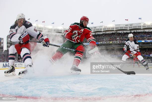 Patrik Elias of the New Jersey Devils scores a first period goal against the New York Rangers during the 2014 Coors Light NHL Stadium Series at...