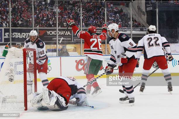 Patrik Elias of the New Jersey Devils scores a goal in the first period against the New York Rangers during the 2014 Coors Light NHL Stadium Series...