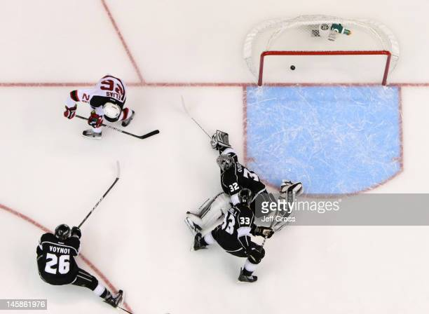 Patrik Elias of the New Jersey Devils scores a goal over Willie Mitchell and goaltender Dustin Brown of the Los Angeles Kings in the third period of...
