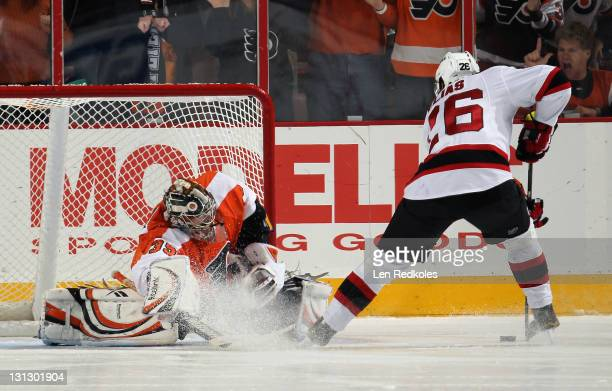 Patrik Elias of the New Jersey Devils scores against Sergei Bobrovsky of the Philadelphia Flyers in the final round of the shootout on November 3...