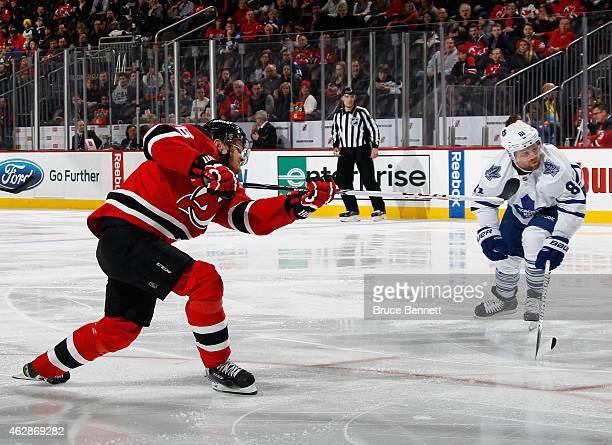 Patrik Elias of the New Jersey Devils scores his 400th career goal at 123 of the second period against the Toronto Maple Leafs at the Prudential...