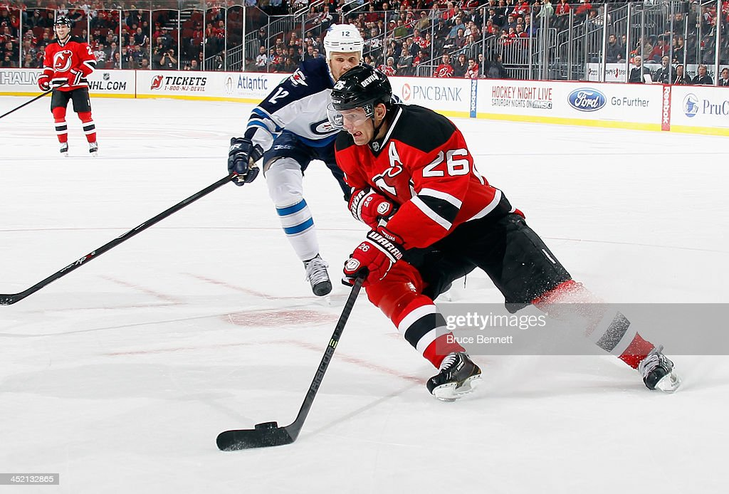 <a gi-track='captionPersonalityLinkClicked' href=/galleries/search?phrase=Patrik+Elias&family=editorial&specificpeople=201827 ng-click='$event.stopPropagation()'>Patrik Elias</a> #26 of the New Jersey Devils skates against the Winnipeg Jets at the Prudential Center on November 25, 2013 in Newark, New Jersey. The Jets defeated the Devils 3-1.