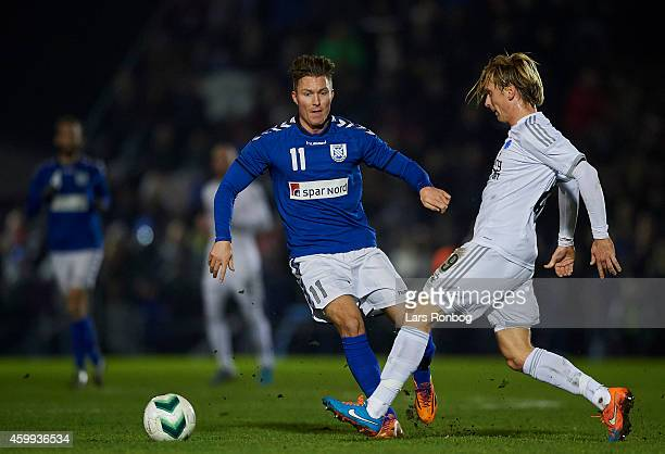 Patrik Jensen of Greve Fodbold and Christian Poulsen of FC Copenhagen compete for the ball during the DBU Pokalen Danish Cup match between Greve IF...
