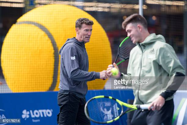 Patrik Kuehnen tournament director BMW Open and Maximilian Marterer talk to each other during the BMW Open Show Match at Airport Munich on April 19...