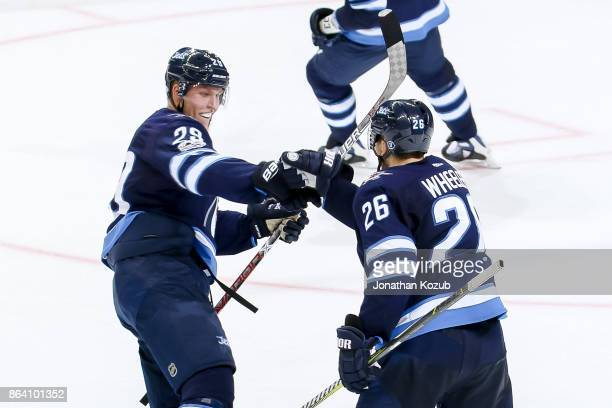 Patrik Laine and Blake Wheeler of the Winnipeg Jets celebrate a second period goal against the Minnesota Wild at the Bell MTS Place on October 20...