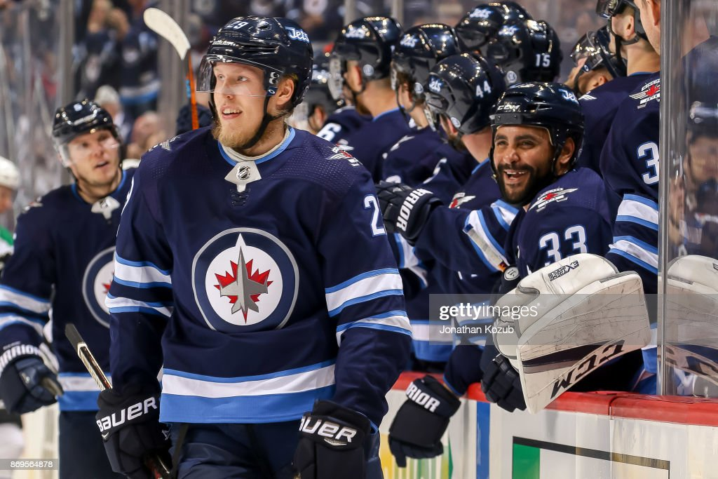 Patrik Laine #29 and Dustin Byfuglien #33 of the Winnipeg Jets are all smiles as they celebrates Laine's first period goal against the Dallas Stars at the Bell MTS Place on November 2, 2017 in Winnipeg, Manitoba, Canada.