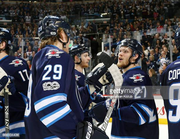 Patrik Laine and Nikolaj Ehlers of the Winnipeg Jets celebrate a 21 victory over the Nashville Predators in the final game of the regular season at...