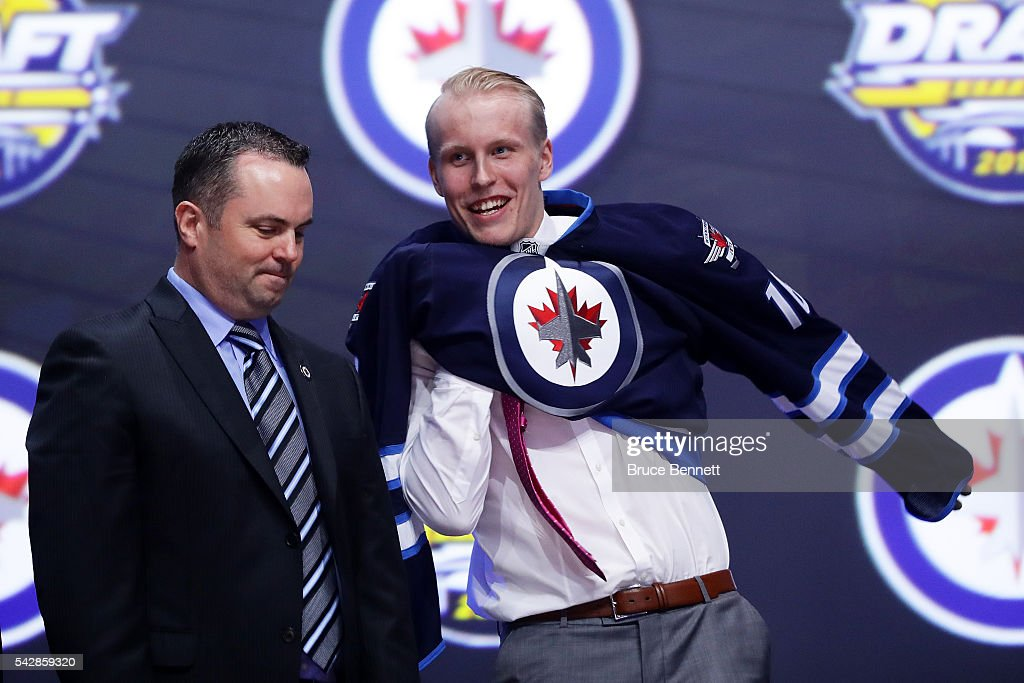 <a gi-track='captionPersonalityLinkClicked' href=/galleries/search?phrase=Patrik+Laine&family=editorial&specificpeople=13600427 ng-click='$event.stopPropagation()'>Patrik Laine</a> celebrates after being selected second overall by the Winnipeg Jets during round one of the 2016 NHL Draft on June 24, 2016 in Buffalo, New York.