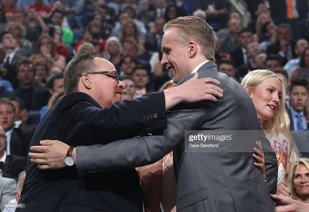 Patrik Laine hugs a member of his family after being selected second overall by the Winnipeg Jets during round one of the 2016 NHL Draft at First Niagara Center on June 24, 2016 in Buffalo, New York.