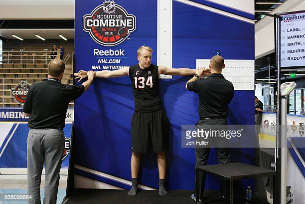 Patrik Laine is measured for Height/Wingspan during the NHL Combine at HarborCenter on June 4 2016 in Buffalo New York